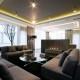 Nowoczesny salon z betonem architektonicznym Hola Design - biuro projektowe