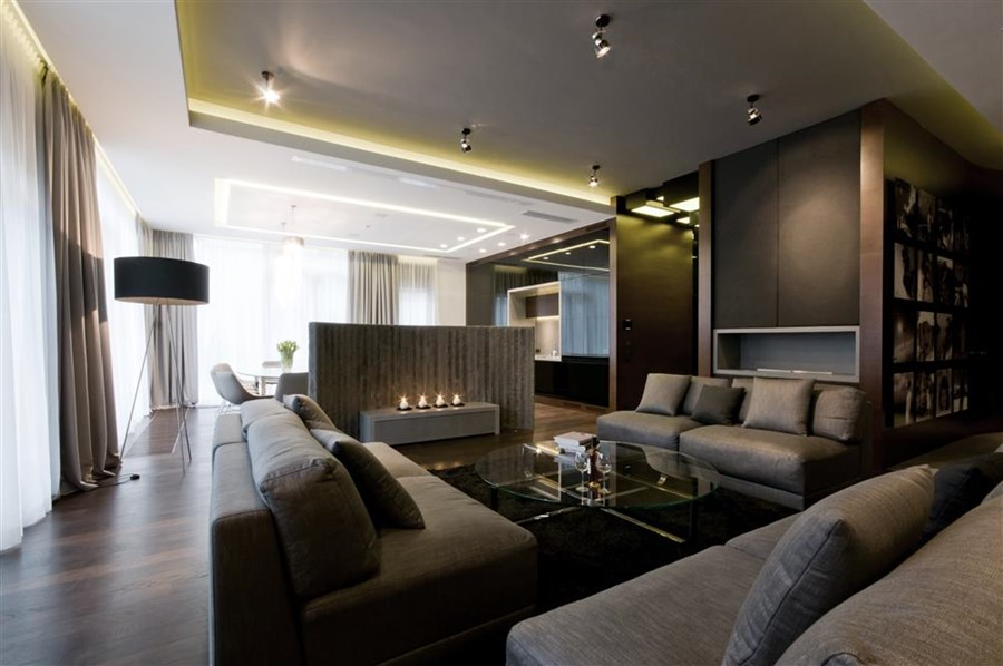 Nowoczesny salon z betonem architektonicznym for High end interior designers london