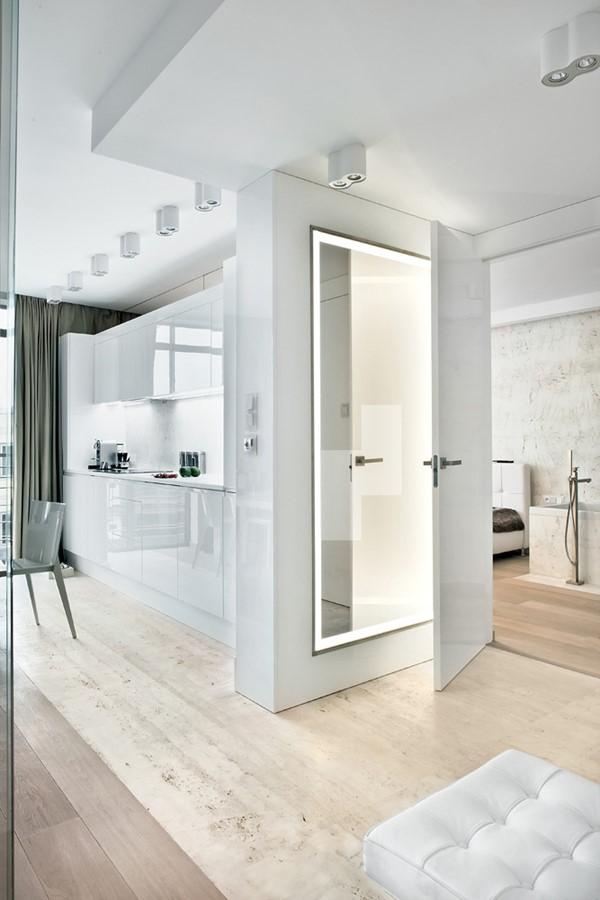 salon z kuchni� oddzielony szklan� ścian� z wewnętrzn�
