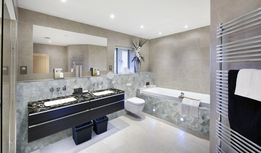 Aranżacja nowoczesnej łazienki w kamienną umywalką - oryginalna łazienka
