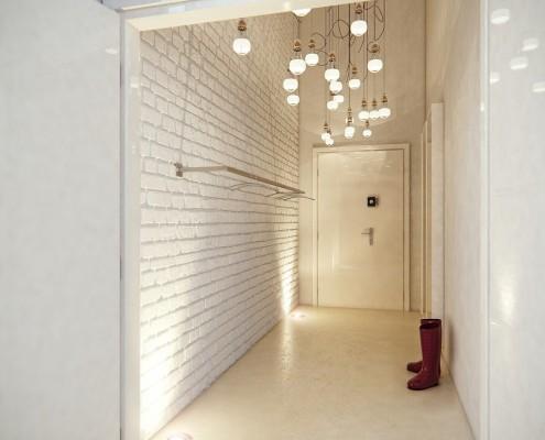 Biały przedpokój ze ścianą z cegły