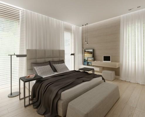 Jasna sypialnia z niewielkim biurkiem w beżach