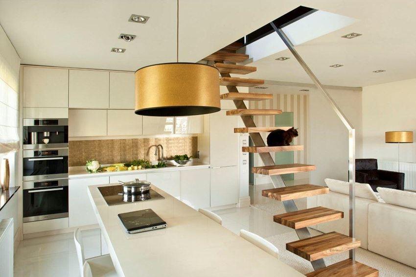 Otwarta kuchnia w bieli Pracownia Architektury Wnetrz Jeżewska & Zakrawacz