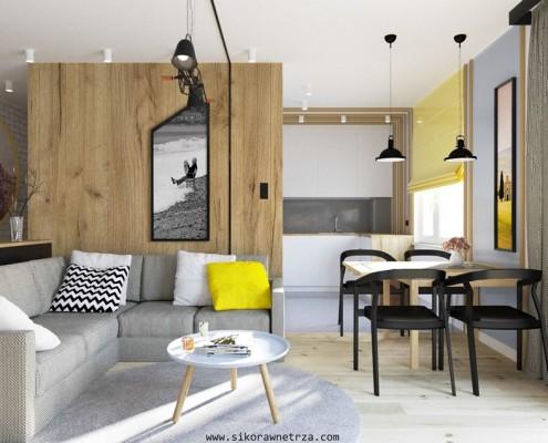 Salon z małą kuchnią i jadalnią Sikora Wnętrza