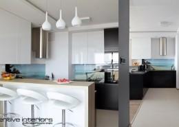 Otwarta kuchnia z oszkloną grafiką Inventive Interiors