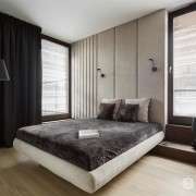 Piękna sypialnia w minimalistycznym wydaniu z tapicerowaną ścianą