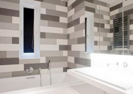 Szare płytki w łazience Casamila