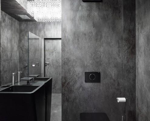 Elegancka łIndustrialna łazienka w czerni i graficieazienka cała w laminamie A8 Architektura