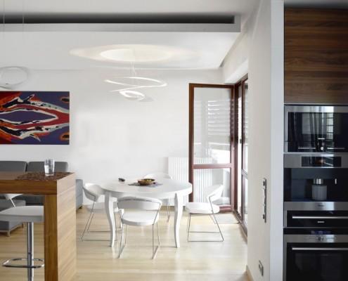 Kuchnia i salon w nowoczesnym wnętrzu PIK Studio