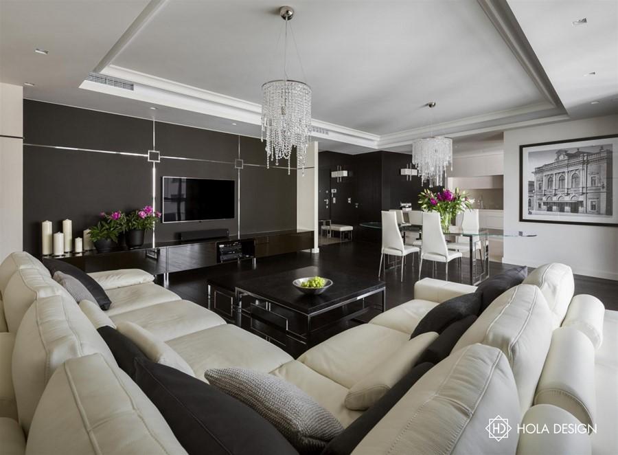 Modern art deco w salonie połączonym z jadalnią Hola Design - biuro projektowe