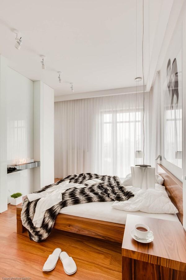 Nowoczesna sypialnia z biokominkiem - Architektura, wnętrza, technologia, design - HomeSquare