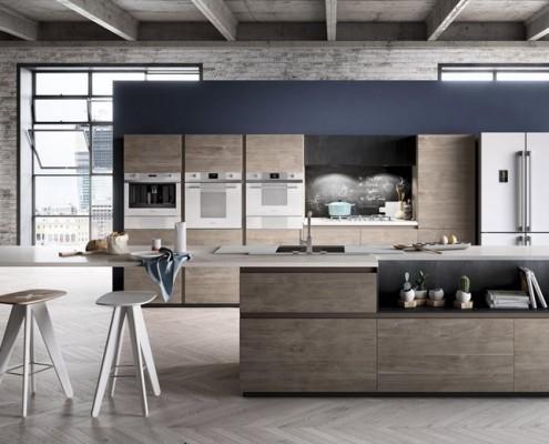 Otwarta kuchnia w lofcie Smeg - ściana z cegły