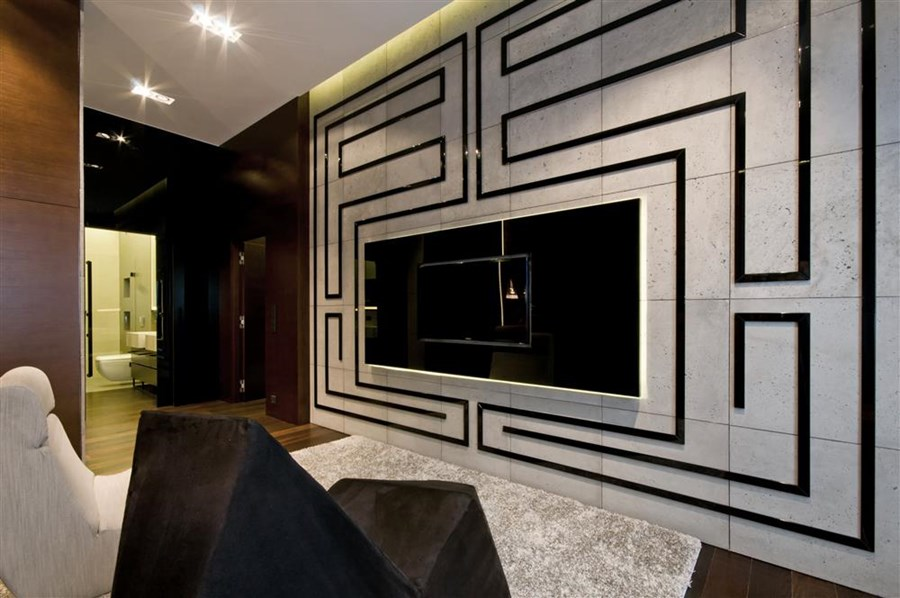 betonowa ściana TV z geometrycznym kontrastem