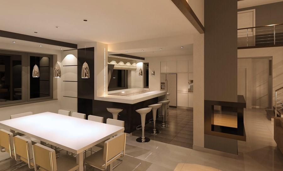 Biel w kuchni otwartej na jadalnię - przestronne wnętrza