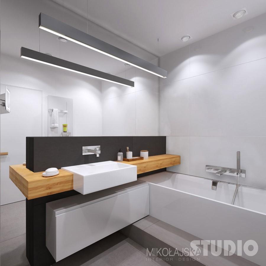 Nowoczesna, szara łazienka przełamana bielą - Mikołajska Studio