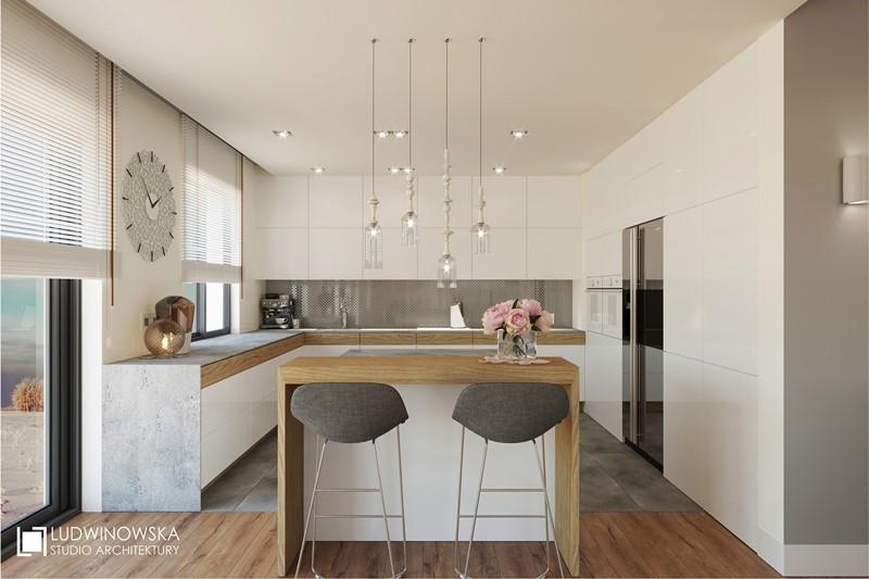 Biała zabudowa w otwartej kuchni - Ludwinowska