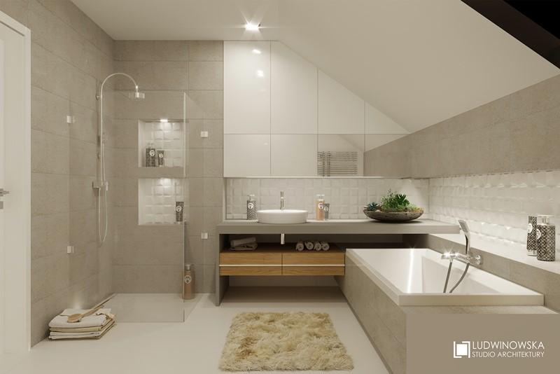 Wanna na poddaszu i delikatne szarości w łazience - Ludwinowska