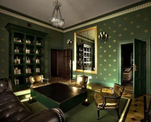 Ciemnozielony pokój wypoczynkowy w klasycznym stylu