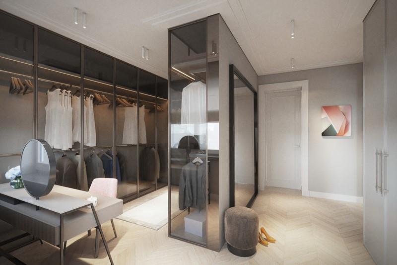 Projekt przestronnej garderoby z przeszklonymi szafami