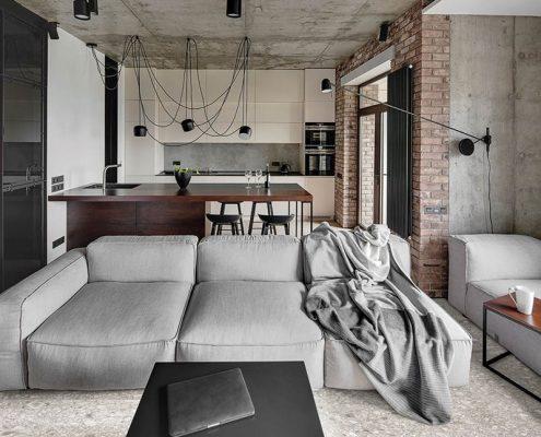 Industrialny salon z kuchnią - płytki podłogowe imitujące kamień Stile Libero