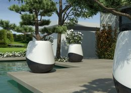 Duże, biało-czarne donice ogrodowe na tarasie