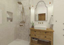 Jasna łazienka ze złotymi elementami