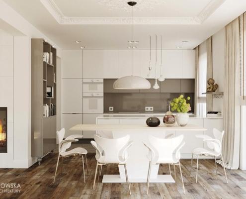 Aranżacja otwartej kuchni z białą zabudową