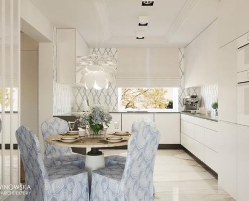 Biała, otwarta kuchnia przełamana błękitem