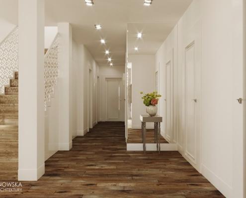 Biały przedpokój z drewnianą podłogą