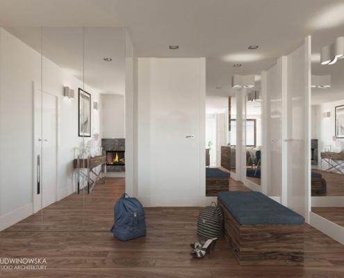 Ciemne, drewniane podłogi w jasnym przedpokoju