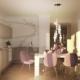 Szaro-biała kuchnia z jadalnią i różowym akcentem