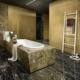 Łazienka w odcieniach czerni i mosiądzu