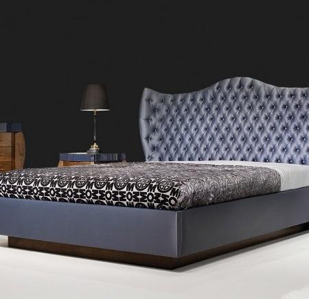 Tapicerowane łóżko z pikowanym wezgłowiem Lunetta