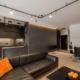 Industrialny salon otwarty na jadalnię i kuchnię