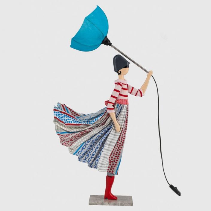 Lampka dziewczynka we wzorzystej sukience foni